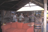 Tourists relax at the bar in the Damaraland Camp, a tourist lodge managed by the Torra Conservancy ... / ©: WWF-Canon / Jan Vertefeuille