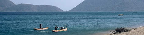 Local villagers with traditional dugout canoes at Lake Malawi (also known as lake Nyasa). Chembe ... rel=