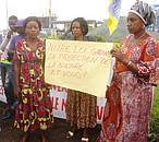 Women against oil exploration hold poster,