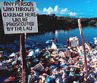 Trash dumped in mangrove forest, Hol Chan Marine Reserve, Belize. / ©: WWF-Canon / Anthony B. RATH