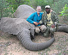 Dr Martin Tchamba (right) and Dr Mike Loomis pose beside the elephant which a few minutes latter charged on the team and injured Martin