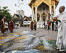 A monk at Wat That Thong temple in Bangkok During a Buddhist merit-making ceremony to pray for the tens of thousands of elephants poached annually. 9 March 2013.  