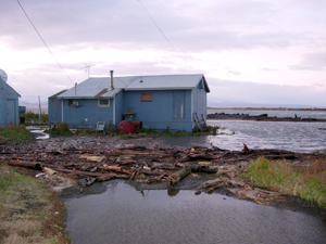 A home sits perilously close to the water's edge. Unalakleet, Alaska. / ©: Native Village of Unalakleet