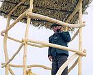 Conservation officer Bairam Jumaev on a fire prevention platform constructed with WWFsupport