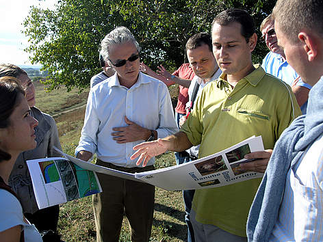 Salvatore Gabola, Director of Public Affairs for Coca-Cola Europe, inspecting a wetland restoration ... rel=