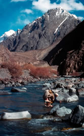 Porter crossing river, Khunjerab National Park, Pakistan. / &copy;: WWF-Canon / Hartmut JUNGIUS