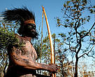 Local tribesman in the TransFly. The head piece is made from the feathers of the cassowary bird. Rhoku, Papua New Guinea.