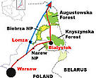 The Polish government's preferred route for the Via Baltica expressway via Bialystok and protected areas (red) and the alternative route via Lomza (blue), which bypasses the protected areas.<BR>