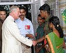 HRH greets Kadar tribal community members from the WWF project site in Vazhachal, Kerala with Mr. Tiju C Thomas of WWF-India doing the introductions.