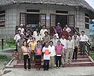 Villagers from the Thung Long commune proudly show off their Red Book certificates