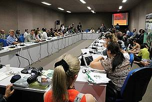 Delegates seated around table at side-event at Rio+20, entitled Forest Green Economy and South-South Cooperation