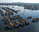 Houses flooded by Hurricane Katrina with the city in the background, New Orleans