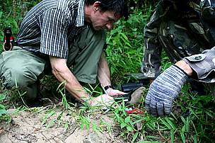 WWF Thailand staff and rangers from the Kuiburi National Park search for tiger tracks.