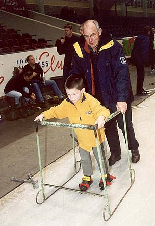 Henk Kroes teaches his son to ice skate.