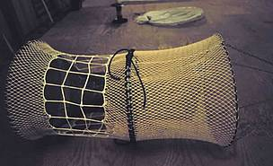 A combination turtle excluder device/bycatch reduction device manufactured by Saunders Marine ... / &copy;: NOAA