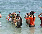 Students learn how to snorkel on a field trip to Bay Canh Island.