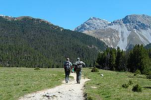 Two park rangers on patrol. Swiss National Park, Graubnden, Switzerland.