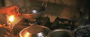Cooking with a biogas stove, instead of burning firewood, eases the workload of women and saves forests.