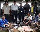 Mr. Anusit Kanjanapol (standing, centre) leads the Royal Thai Customs Officers team who confiscated 205kg of tiger, clouded leopard and panther carcasses which would have fetched US$17,650 on the black market.