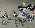 Tools of a terrible trade : leg-hold traps, spears, and knives to kill a tiger along with the cooking utensils and rations of the poachers.