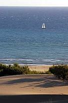 Sand dunes, sailing boat on the Mediterranean Sea in the background. Patara, Turkey. / ©: WWF-Canon / Michel GUNTHER