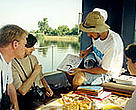 Tourists enjoy a scenic boat cruise on the Danube Delta on one of the new routes introduced by Alvona