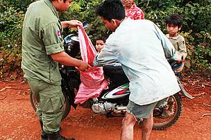 Checking motorist for illegal wildlife products, Eastern Plains, Cambodia
