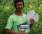 Cambodia ranger Vong with the postcards sent to him under the WWF Cards4tigers action, September 2012