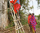 Farmers come down from a watch tower used to spot elephants, Transmara, Kenya.
