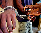 Two convicted elephant poachers are handcuffed at the jail in Oyem, Gabon. Elephant poaching carries a three year sentence.