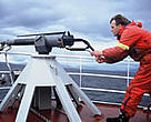 Norwegian whaler demonstrating a harpoon gun.