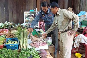 Authorities inspect wild meat at Sen Monorom market, Mondulkiri province.