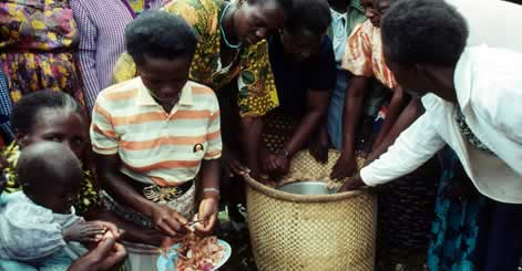 Group of women learning about hay box oven, which is more fuel efficient for cooking. Close to ... rel=