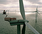 A helicopter lowering a technician to maintain the Horns Rev wind farm, Esbjerg, Denmark