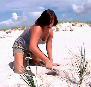 A student from the WWF Allianz Southeast Climate Witness project plants trees on the beach.