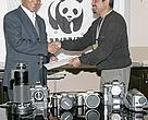 Dr. Ghana Shyam Gurung, Acting Country Representative of WWF Nepal, hands over the cameras to Mr. Bikas Rauniar, the President of NFPJ.