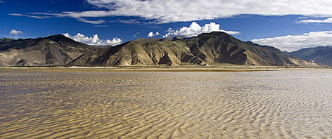 The Yarlung Tsangpo river in Tibet. In India it becomes very wide and is called Brahmaputra. rel=